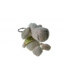 Porte-clés en peluche chien assis avec foulard.