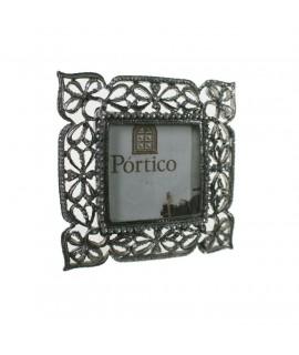 Marco porta fotos metálico cromado diseño lazos con pedrería. Medidas: 11x11 cm.