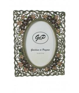 Marco para fotos metálico estilo retro con flores y brillantes. Medidas: 17x13 cm.