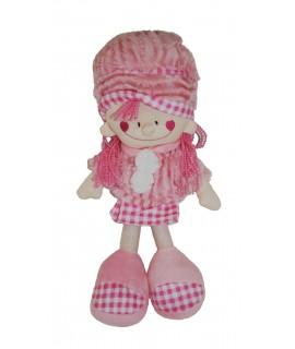 Muñeca de trapo con vestido de color rosa. Medidas: 34x16 cm.