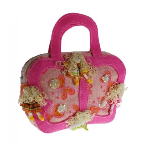 Bolso de mano infantil niña color rosa adornado con muñequitas