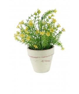Maceta de cerámica con flores amarillas. Medidas: 23x15 cm.