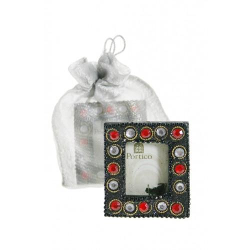 Marco portafotos mini con pedrería y bolsita de envoltorio.