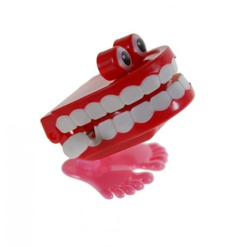 Juguete de cuerda juego infantil dientes saltarines con ojos color rojo