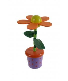 Flor de madera de color naranja para apretar y obtener movimiento