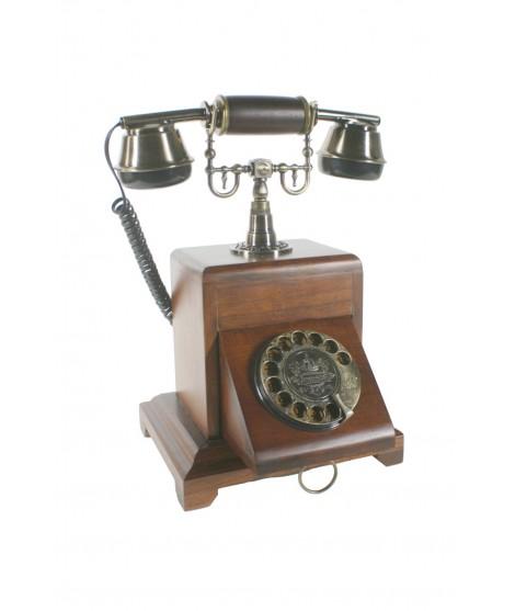 Teléfono de madera con dial giratorio oculto. Medidas: 33x25x22 cm.